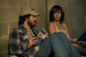 John Gallagher Jr. as Emmett, Mary Elizabeth Winstead as Michelle in 10 CLOVERFIELD LANE, by Paramount Pictures
